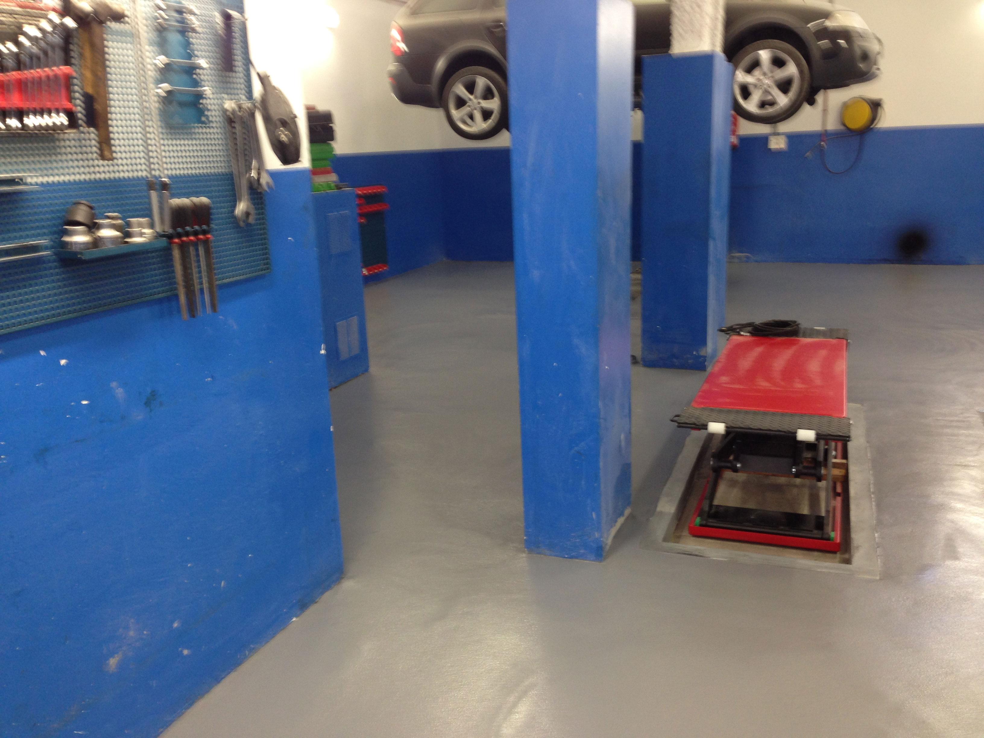 Pavimentación suelo taller mecánico